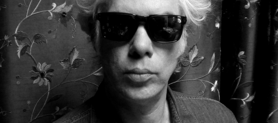 Black and white photo fo Jim with shades